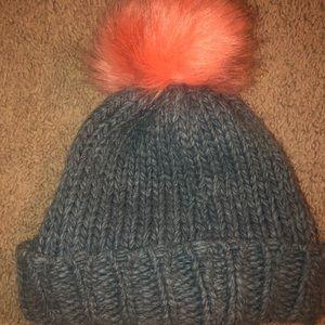 Grey knit winter hat with coral pink Pom Pom